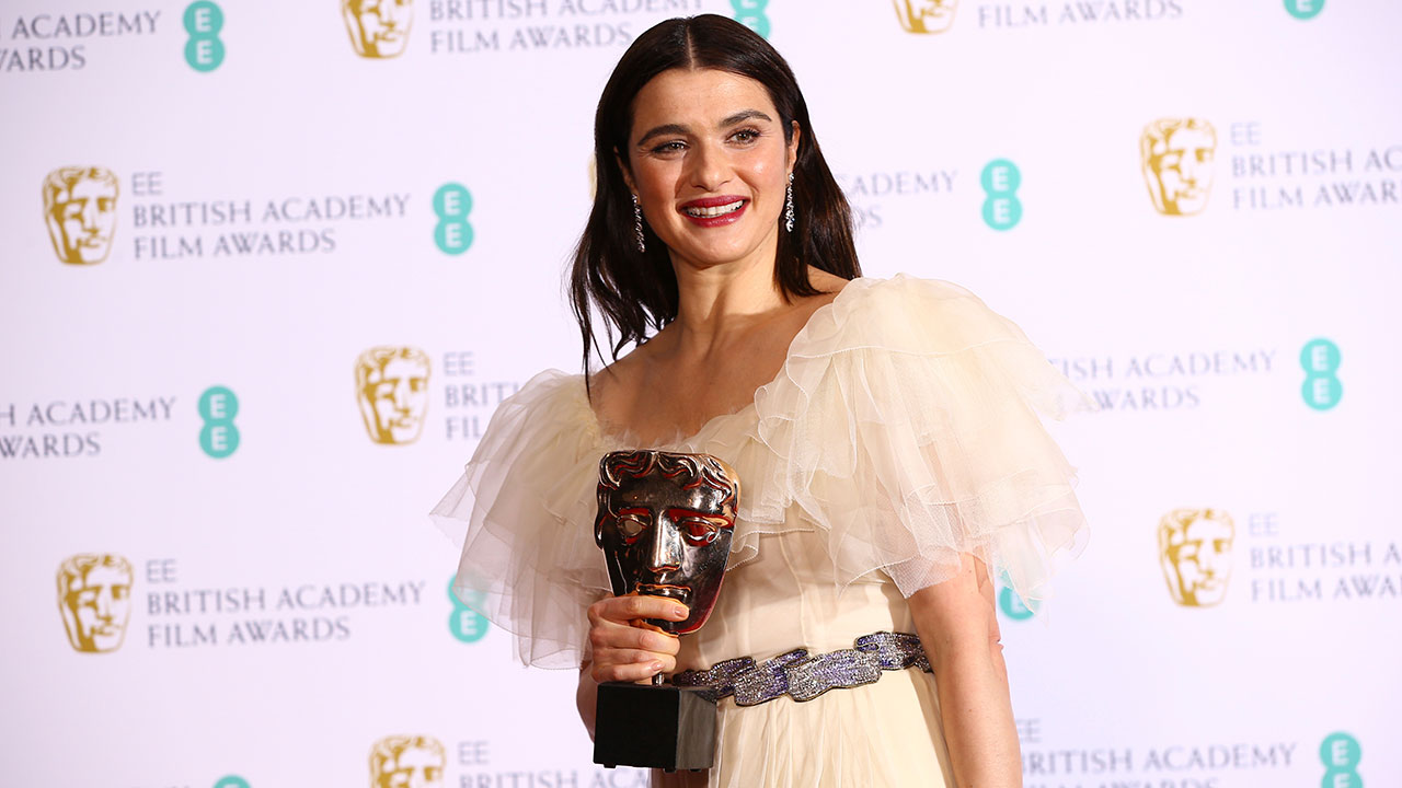 Actress Rachel Weisz poses for photographers backstage with her Best Supporting Actress award for her role in The Favourite at the BAFTA awards in London, Sunday, Feb. 10, 2019.