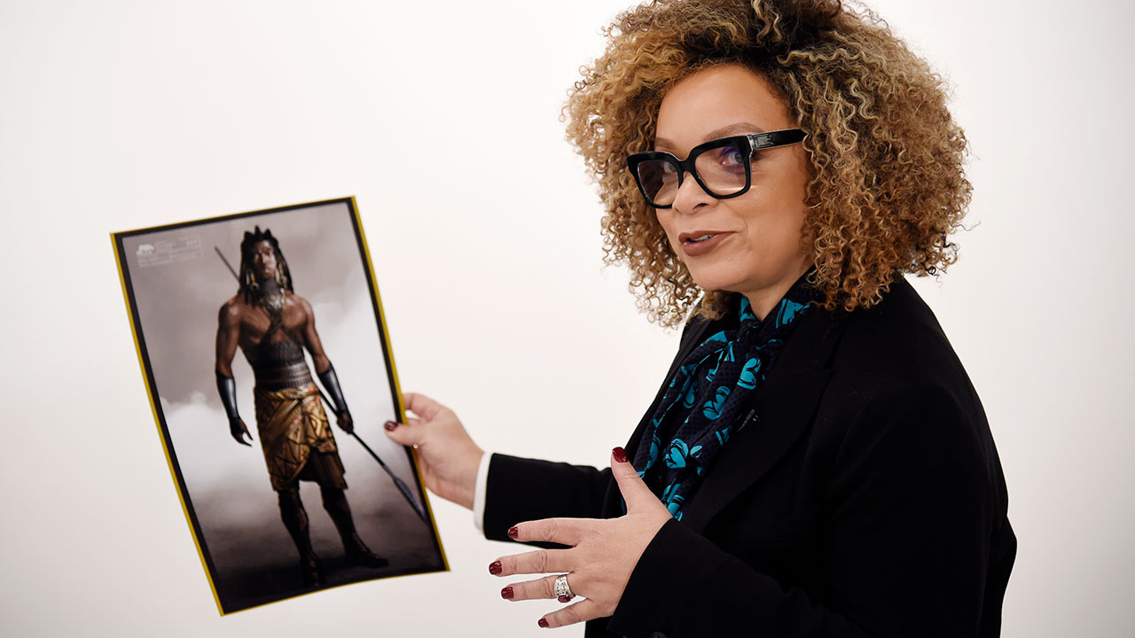 Designer Ruth E. Carter, nominated for an Oscar for best costume designs for Black Panther, poses for a portrait while holding a photo of one of her designs in Los Angeles.