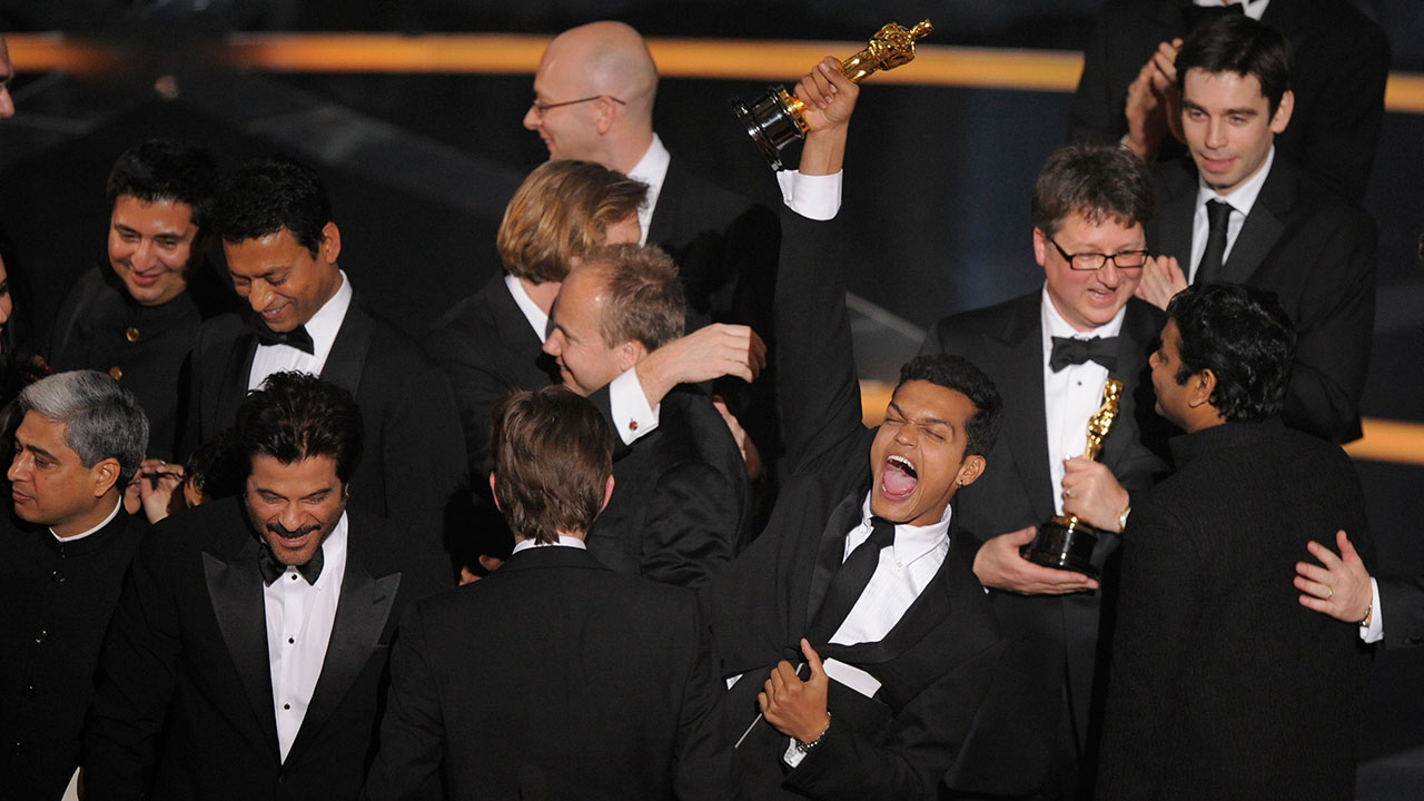 Actor Madhur Mittal along with the cast and crew celebrate after the film Slumdog Millionaire won best picture during the 81st Academy Awards Sunday, Feb. 22, 2009.