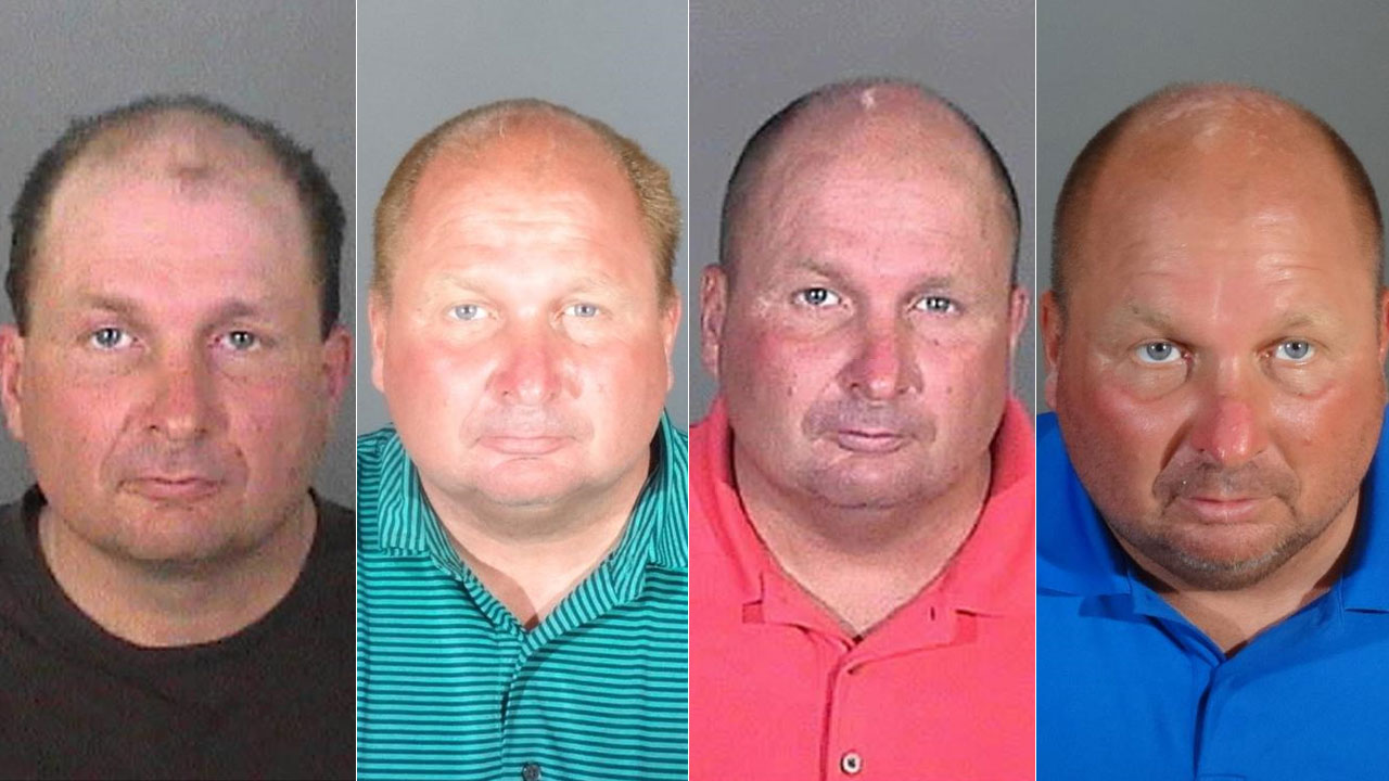 David Clare Lohr, 48, is shown in four different mugshots provided by the FBI.