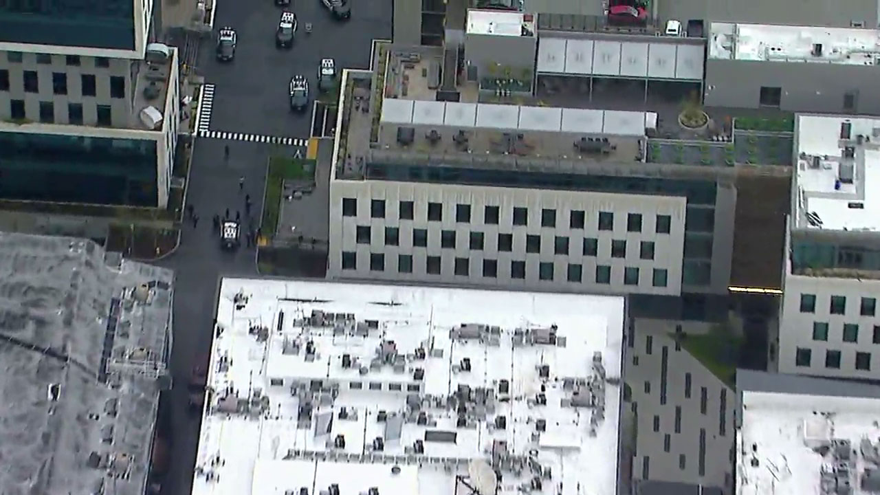 People walked out of a building at the Sunset Bronson Studios in Hollywood amid reports of a man with a gun in a parking structure on Thursday, Feb. 14, 2019.