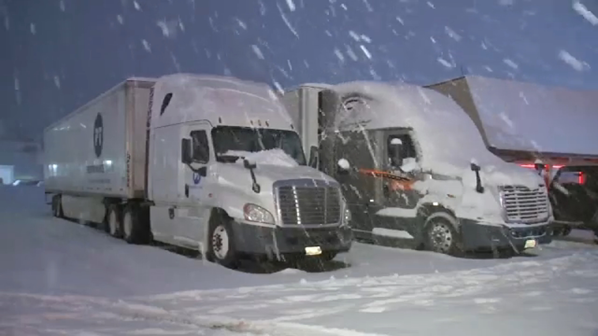 This is an undated photo of big rigs covered in snow along the Grapevine area.