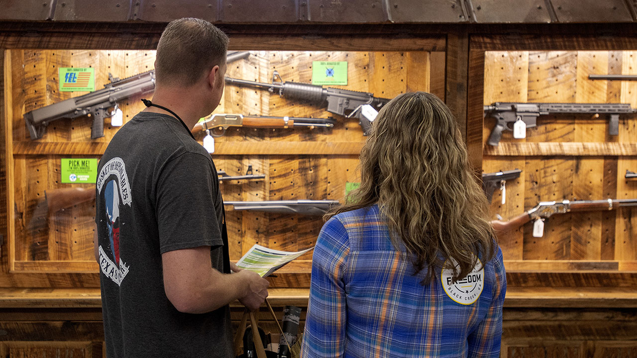 Sean and Lisa Thomas of Texas look at a display of weapons at NRA Annual Meeting on Friday, May 4, 2018 at the Kay Bailey Hutchison Convention Center in Dallas.