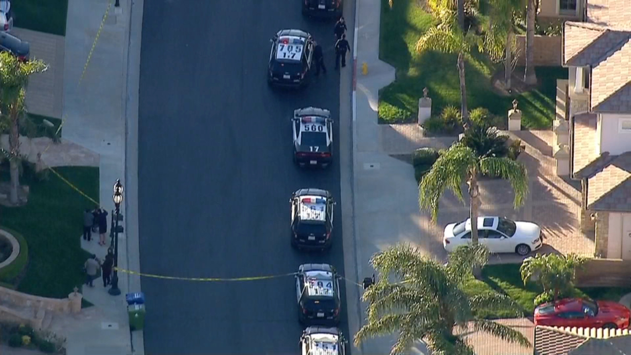Authorities are investigating the deaths of three people at a Porter Ranch home.