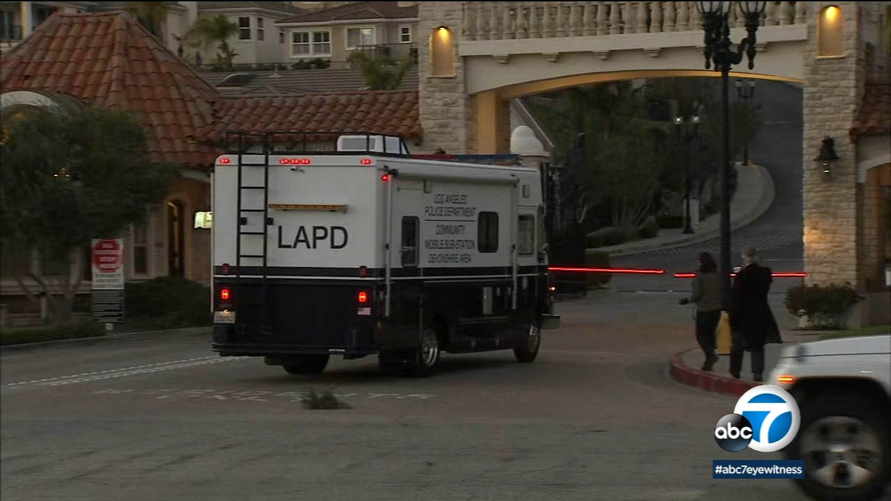 An LAPD vehicle arrives to the scene of a triple homicide at a Porter Ranch home in a gated community on Monday, Feb. 19, 2019.
