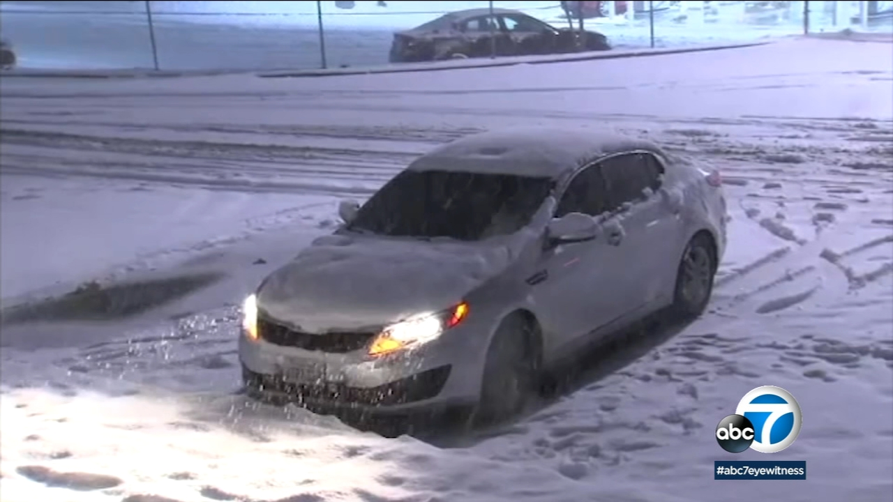 A car is seen stuck in snow in this undated photo.