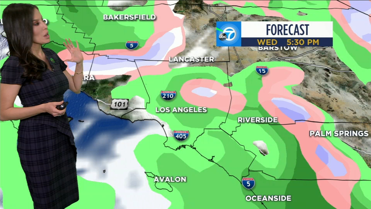 Leslie Lopez shows a map that indicates when rain will arrive to Southern California on Wednesday.