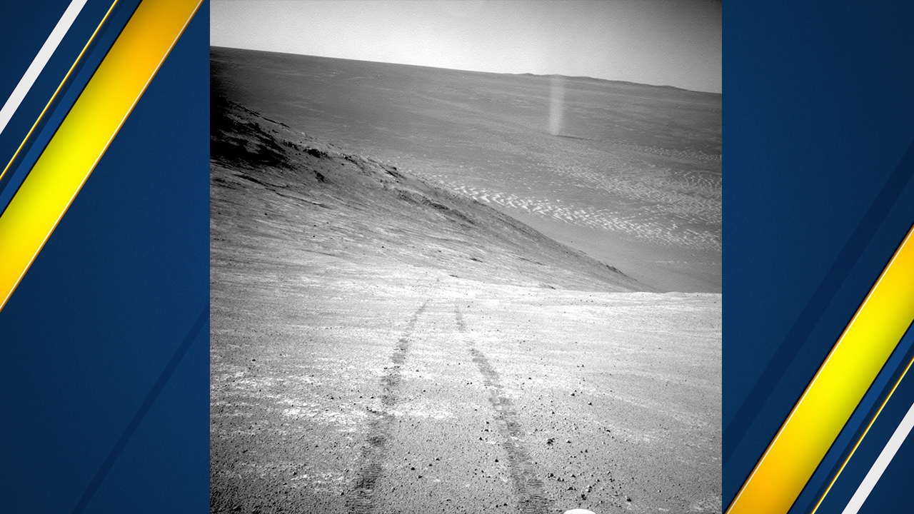 This March 31, 2016 photo made available by NASA shows a dust devil in a valley on Mars, seen by the Opportunity rover perched on a ridge.