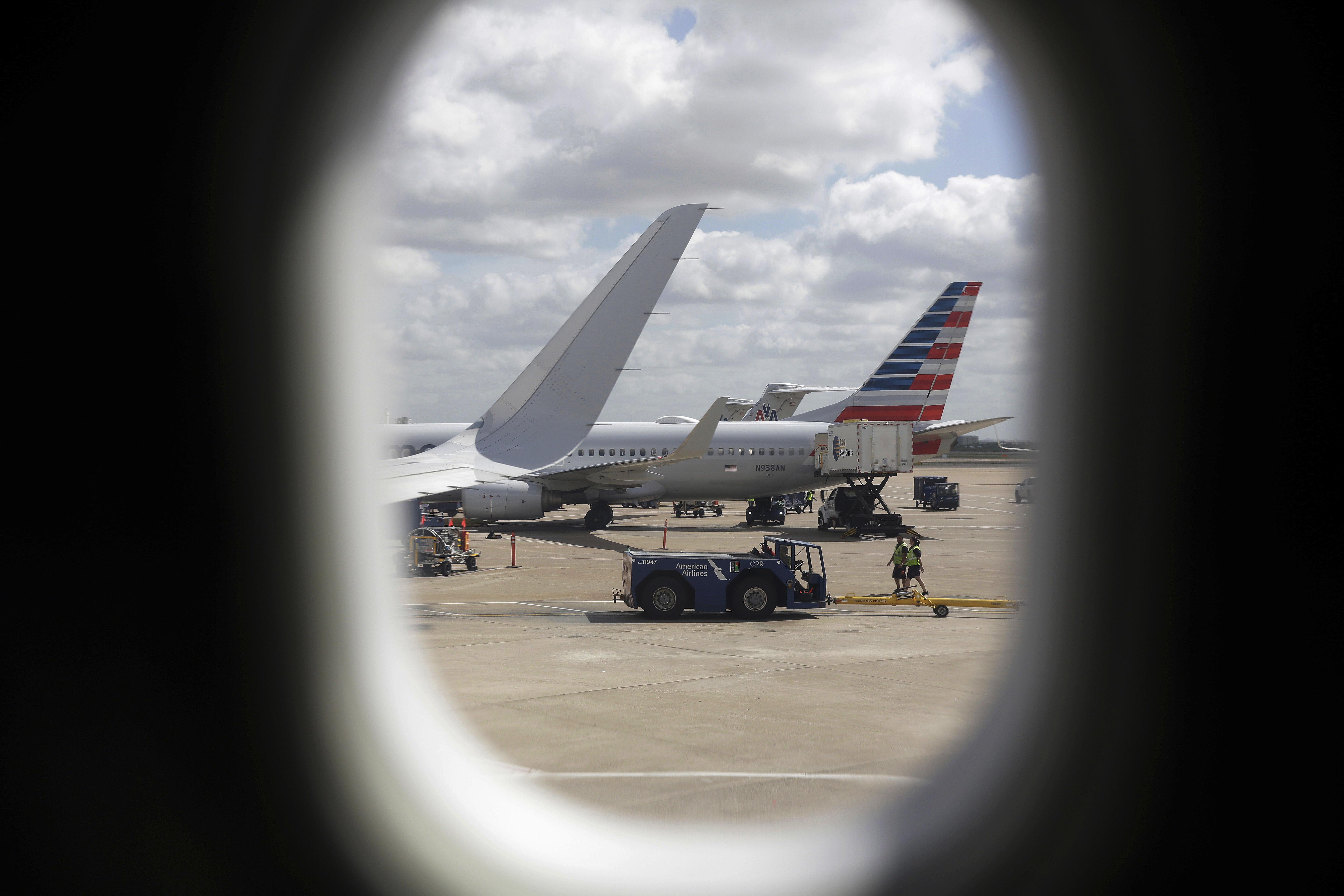 FILE- In this June 16, 2018, file photo, American Airlines aircrafts are seen at OHare International Airport in Chicago.