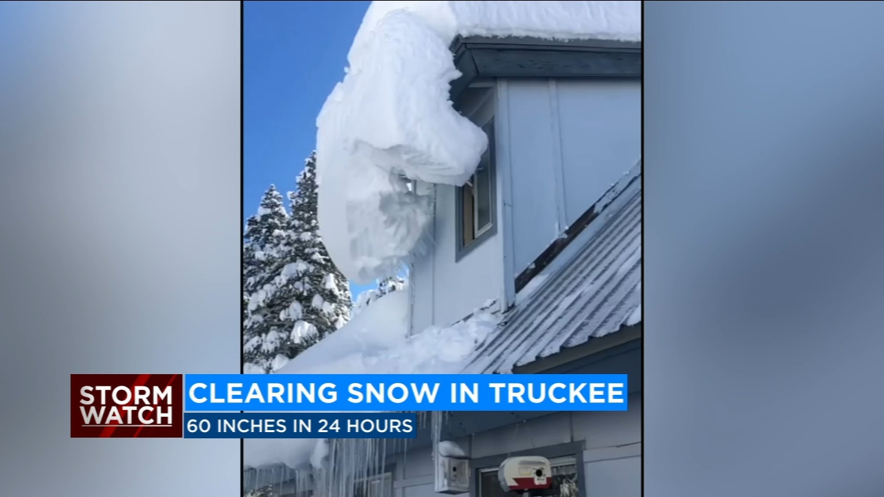 VIDEO: Homeowner clears pile of large snow from rooftop