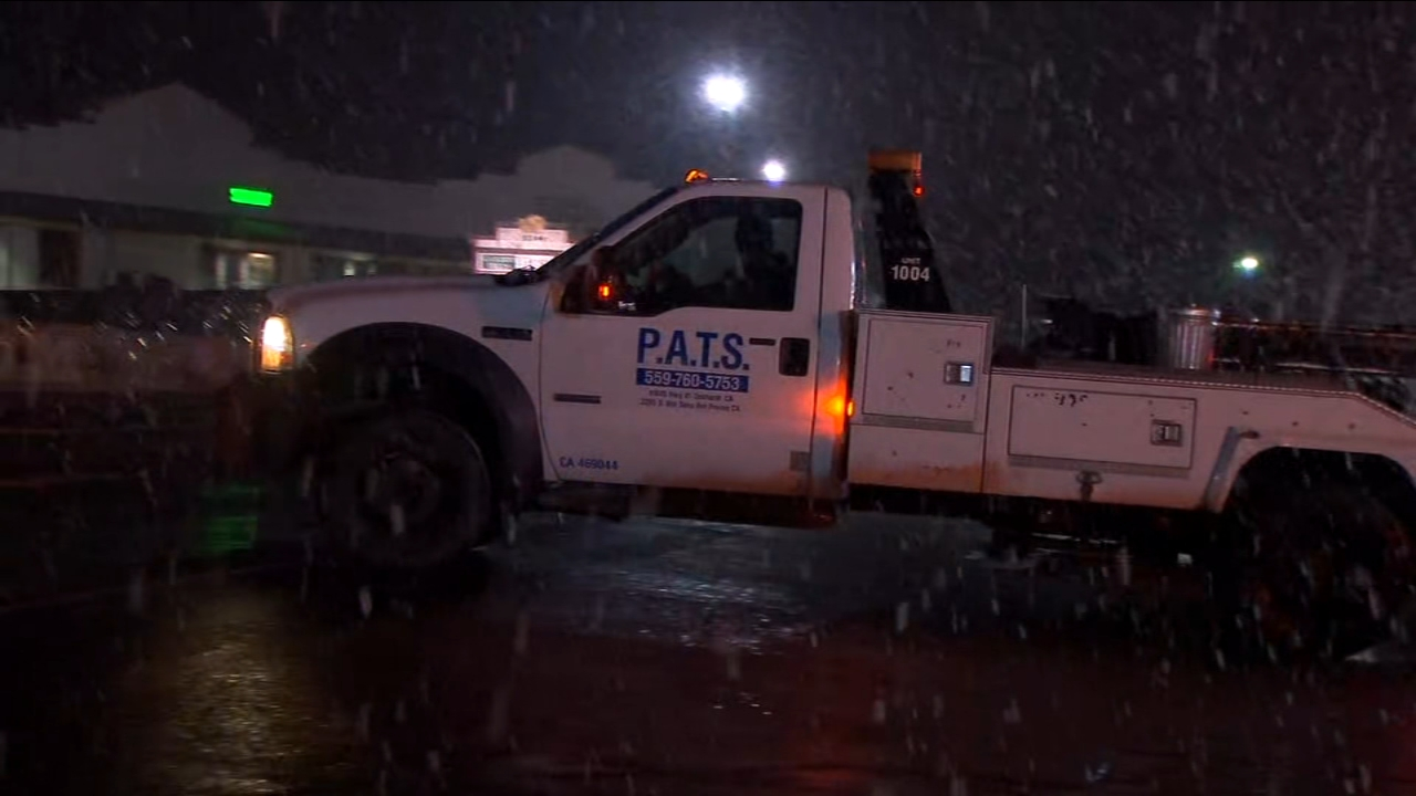 Tow truck drivers brave dangerous road conditions to help drivers trapped in snow