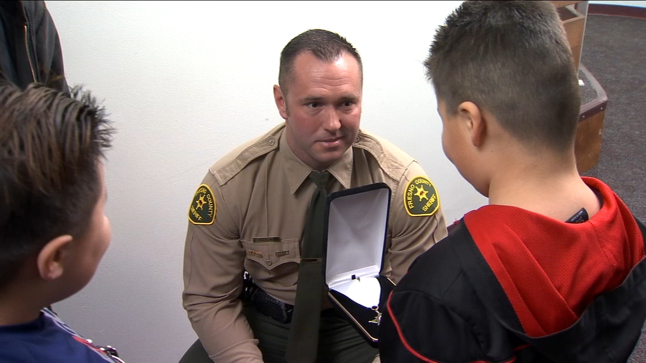 Deputy Robert Pulkownik was honored with the Life Saving Medal for rescuing Richard Sanchez Jr. from a car that had flipped into a canal.