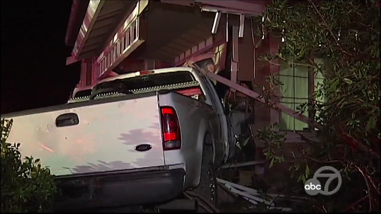 A stolen truck is seen after crashing into a home in Antioch, Calif. on Sunday, Feb. 10, 2019.