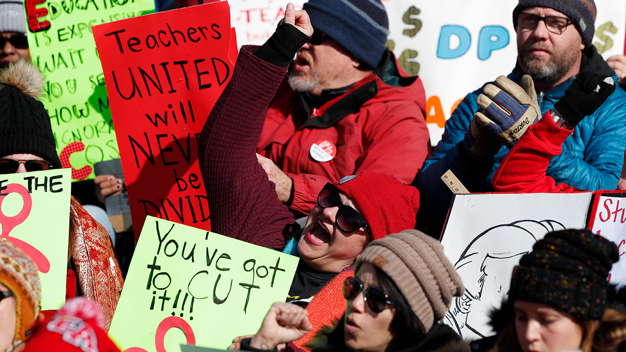 Teachers chant in support during a strike rally on the west steps of the State Capitol Monday, Feb. 11, 2019, in Denver.
