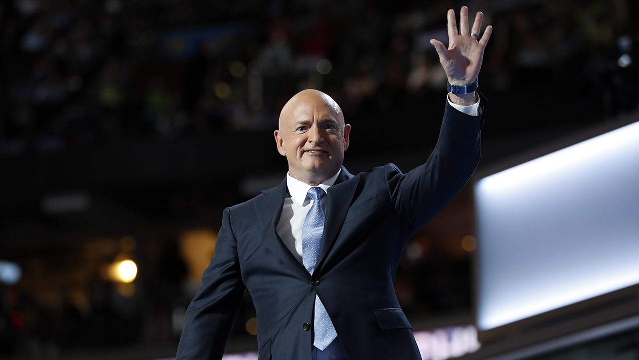 Astronaut Mark Kelly (ret.) waves as he takes the stage at the Democratic National Convention in Philadelphia, Wednesday, July 27, 2016.