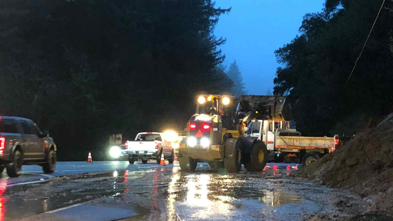 Crews are seen working to remove debris from Highway 17 in the Santa Cruz Mountains on Wednesday, Feb. 13, 2019.