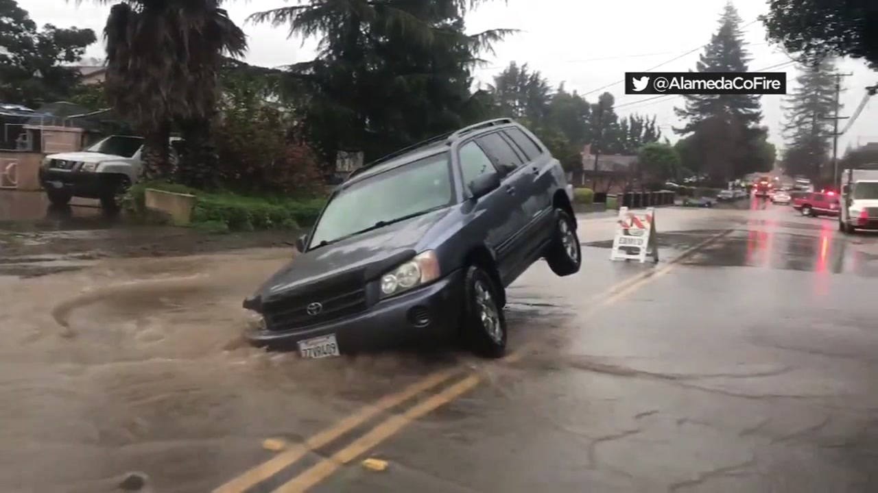 This image shows an SUV stuck in a sinkhole in Castro Valley on Feb. 13, 2019.