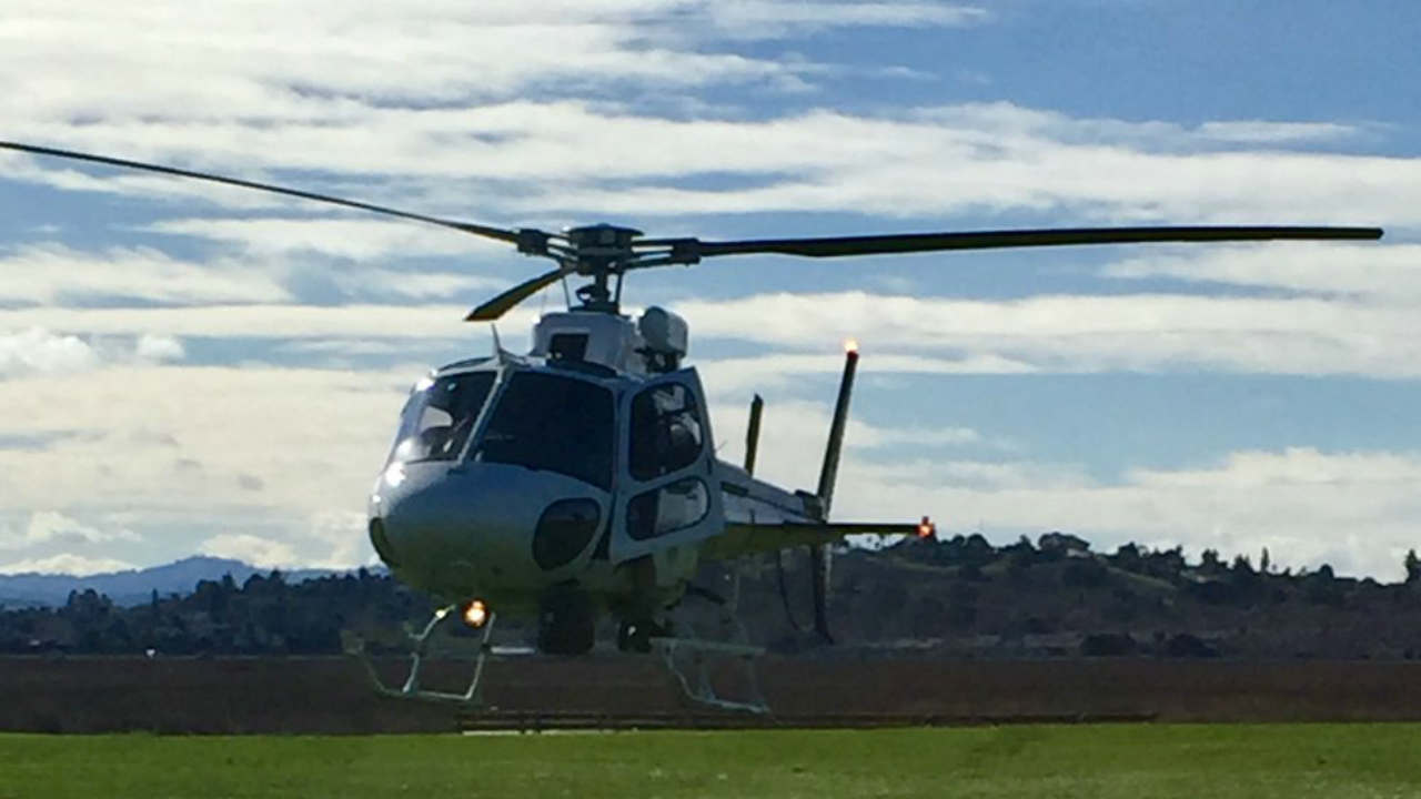 A CHP helicopter is sen in Vallejo, Calif. after a hot air balloon crash on Sunday, Feb. 17, 2019.