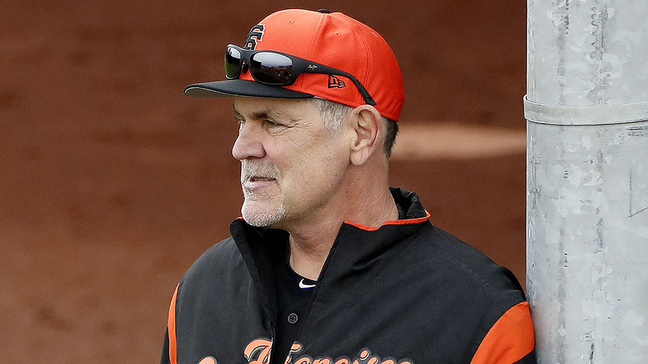 San Francisco Giants manager Bruce Bochy watches his team during a baseball spring training practice, Wednesday, Feb. 13, 2019, in Scottsdale, Ariz.