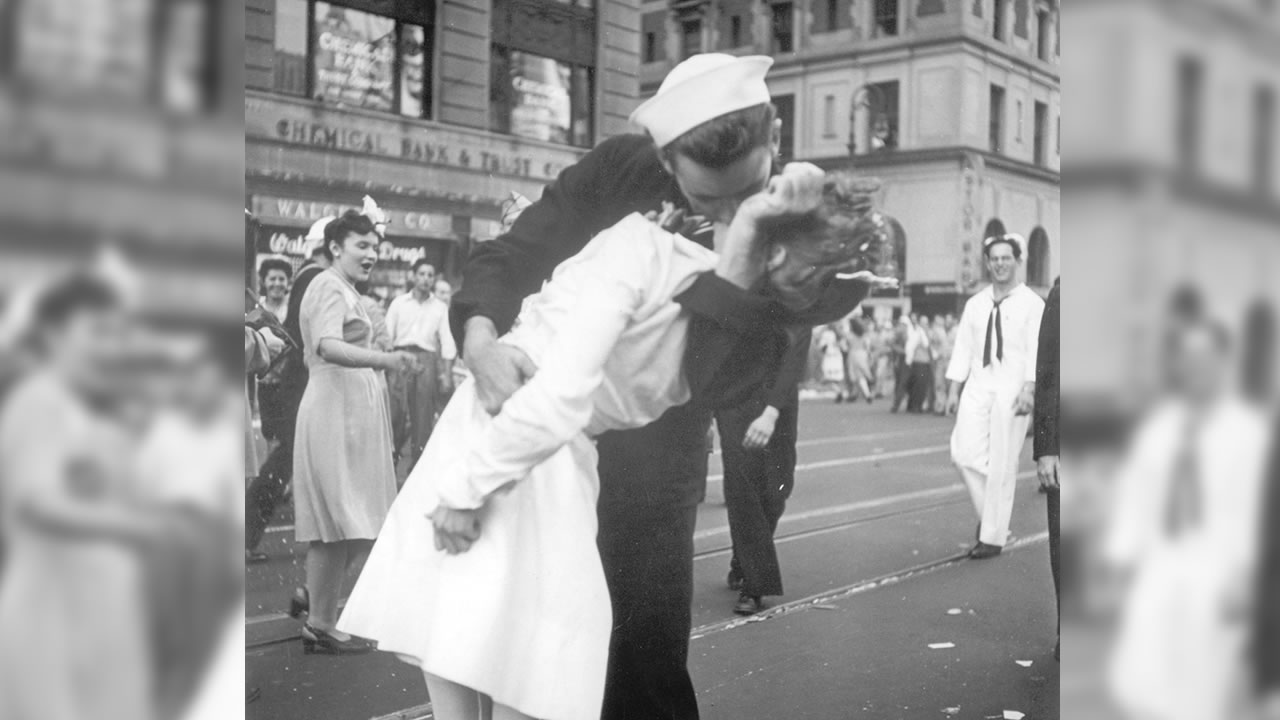 In this Aug. 14, 1945 file photo provided by the U.S. Navy, a sailor and a woman kiss in New Yorks Times Square, as people celebrate the end of World War II.