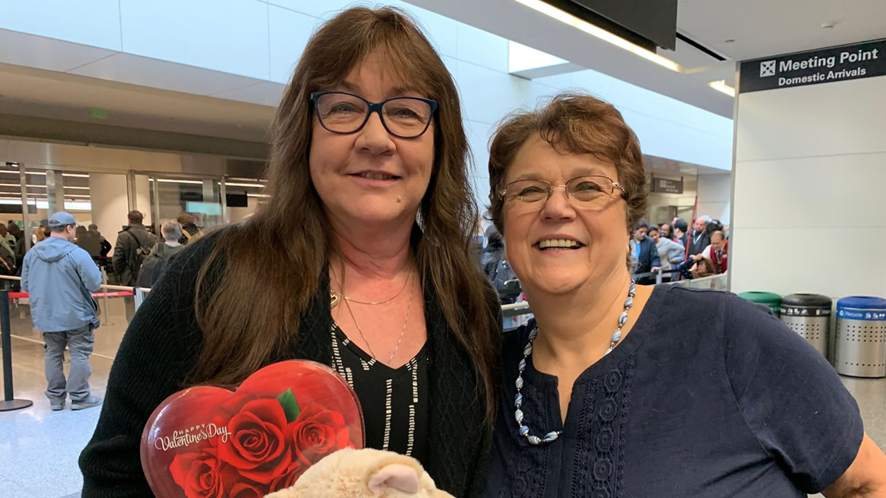 Jackie Bridges-Cameron and Patricia Krohn-Pope meet at San Francisco International Airport.