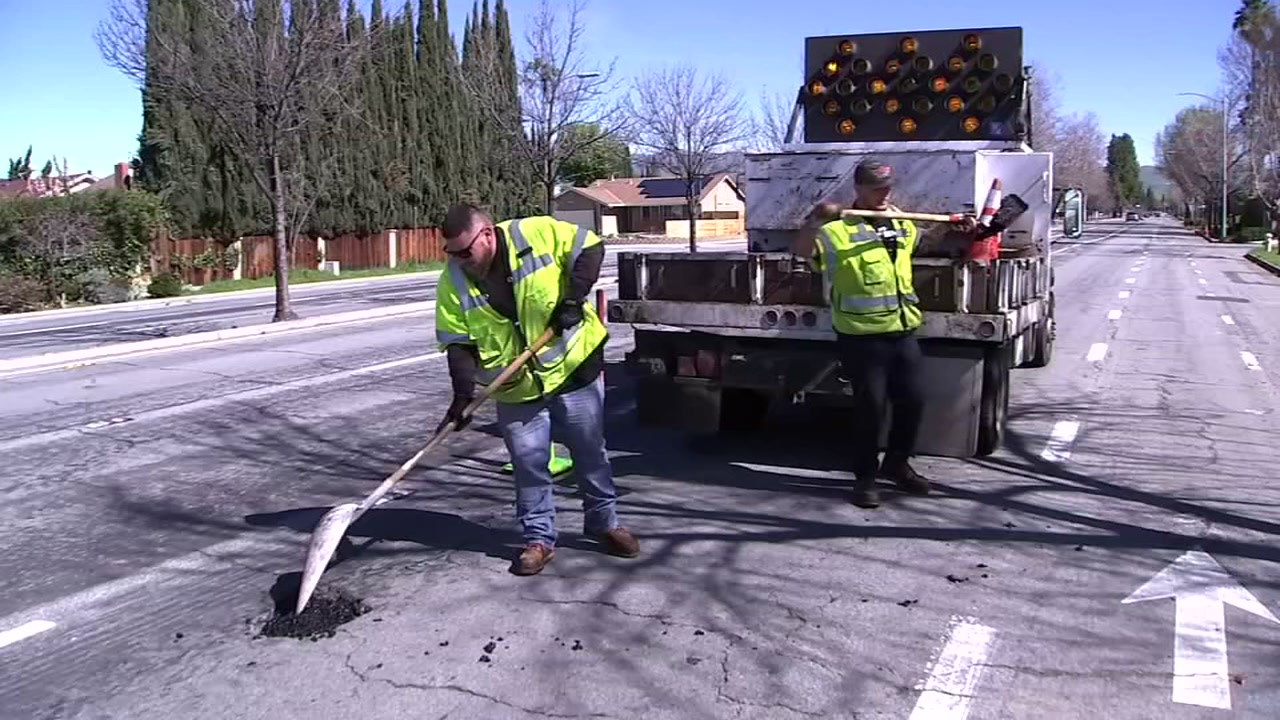 City workers fill one of the many potholes that has emerged since recent, heavy rains soaked San Jose, Calif. on Feb. 22, 2019.