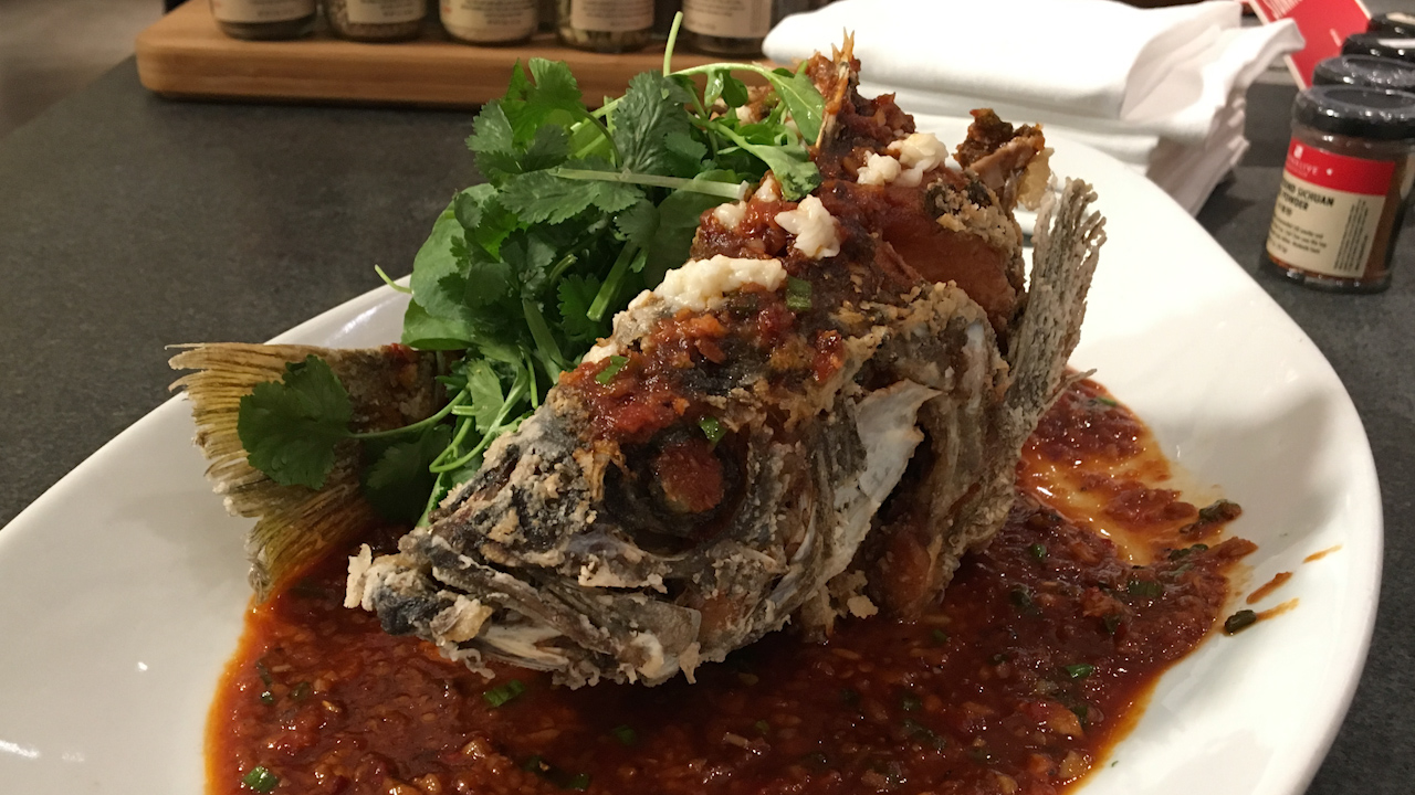 Whole fish, like this one prepared by Chef George Chin from China Live, is a dish that brings good luck and fortune during Lunar New Year.