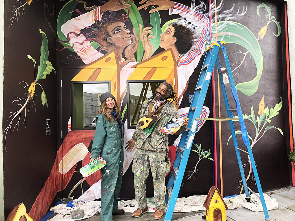 Artists Mona Caron (left) and Mauro Neri in front of their new mural. | Photos: Teresa Hammerl/Hoodline