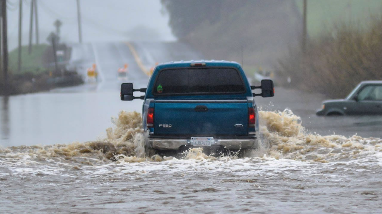 This image shows a truck driving through a flooded roadway in Petaluma, Calif. on Wednesday, Feb. 13, 2019.