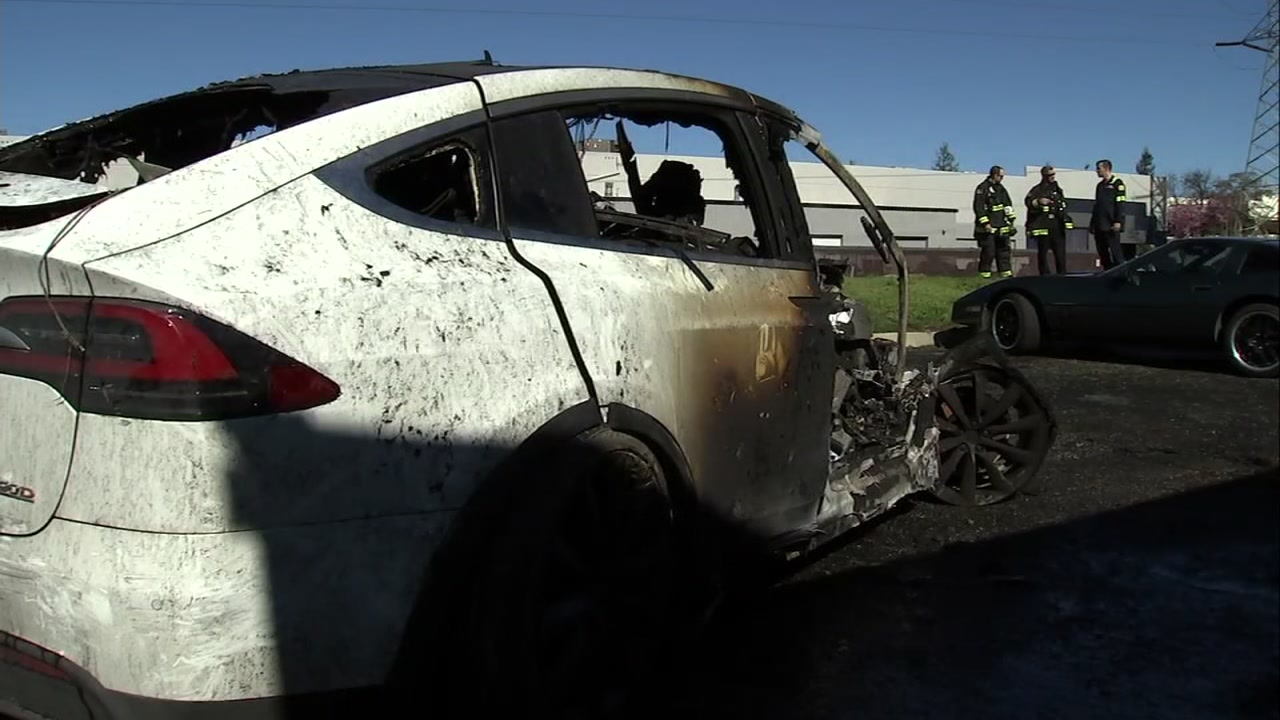 A damaged Tesla Model X is seen after a fiery crash in Fremont, Calif. on Monday, Feb. 18, 2019.
