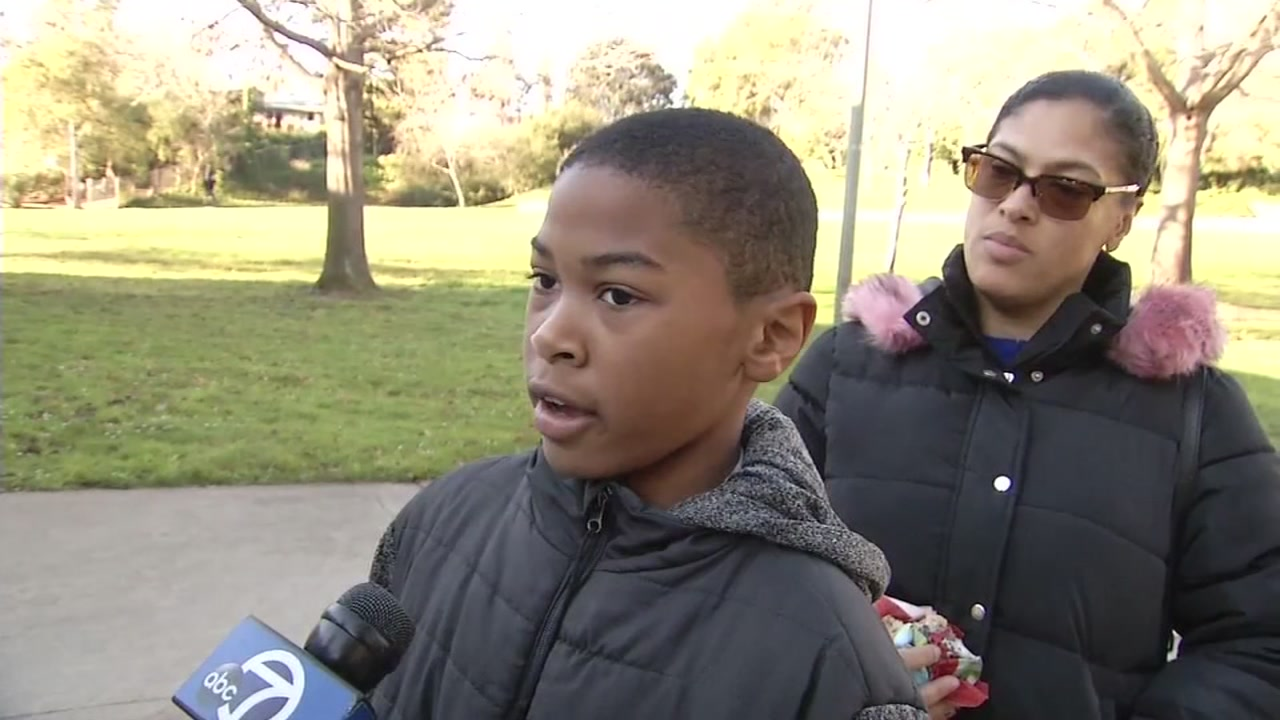 Student speaks to reporter as he is dropped off at rec center during Oakland teacher strike