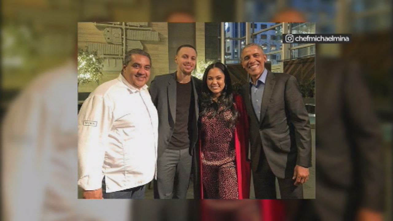 This image shows Former President Barack Obama with Ayesha Curry, Stephan Curry and Chef Michael Mina at International Smoke restaurant in San Francisco on Feb.18.