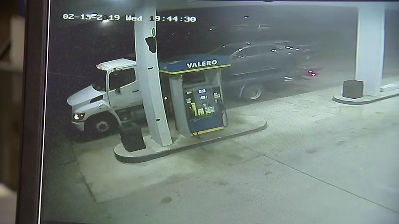 Surveillance video shows a woman take off in a wreckers tow truck.