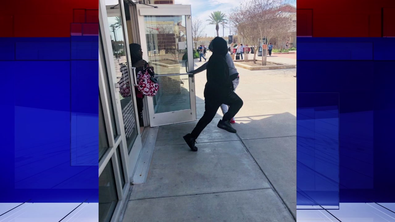 The three men used a sledge hammer to break into the glass case at the Houston Premium Outlet Mall.