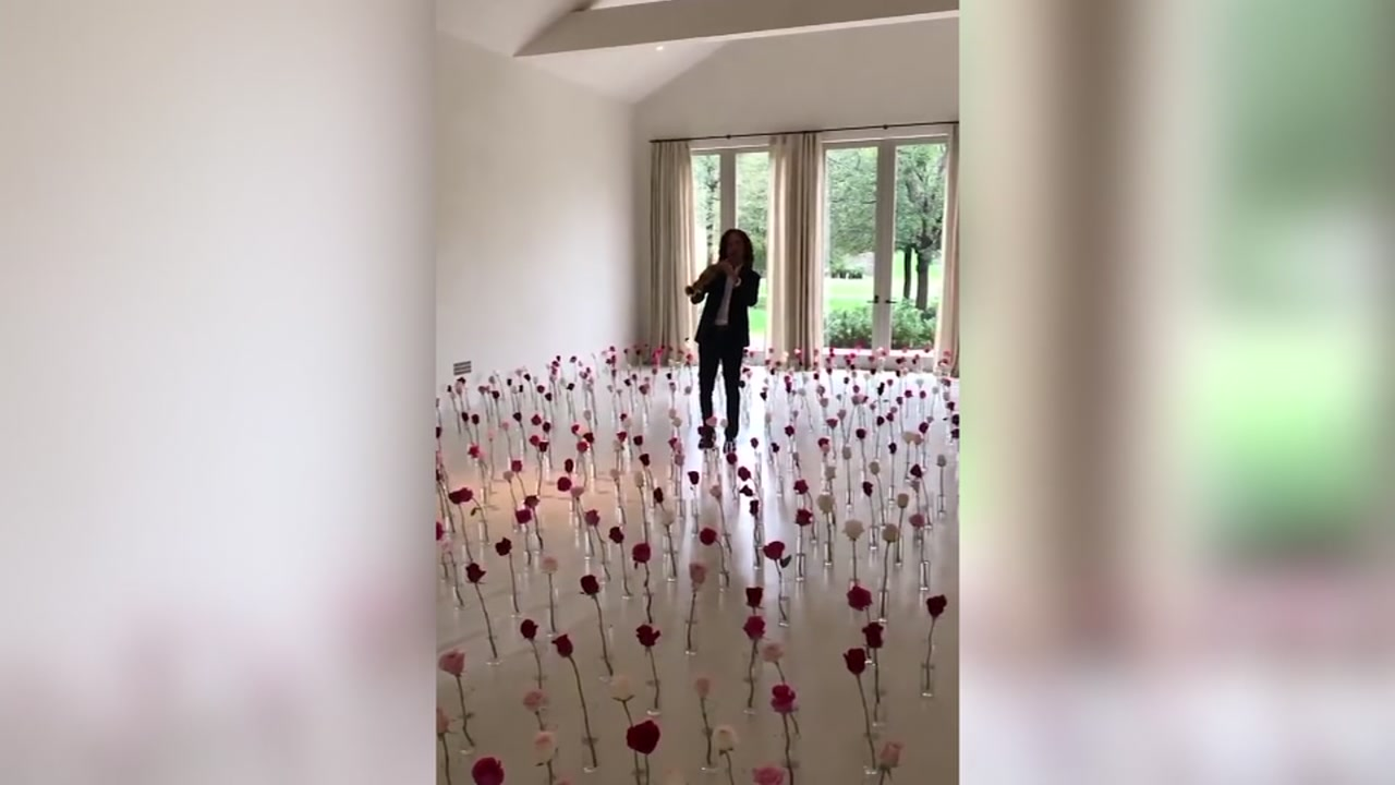 Kanye West surprises wife with a Kenny G serenade for V-Day