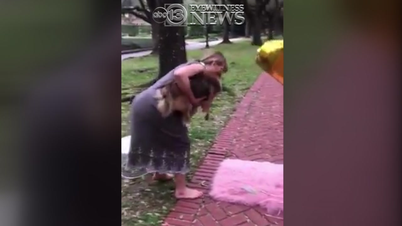 Woman caught on video confronting family taking first birthday photos.