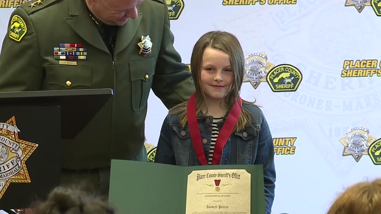 8-year-old girl awarded for saving dads life after he was shot while driving.
