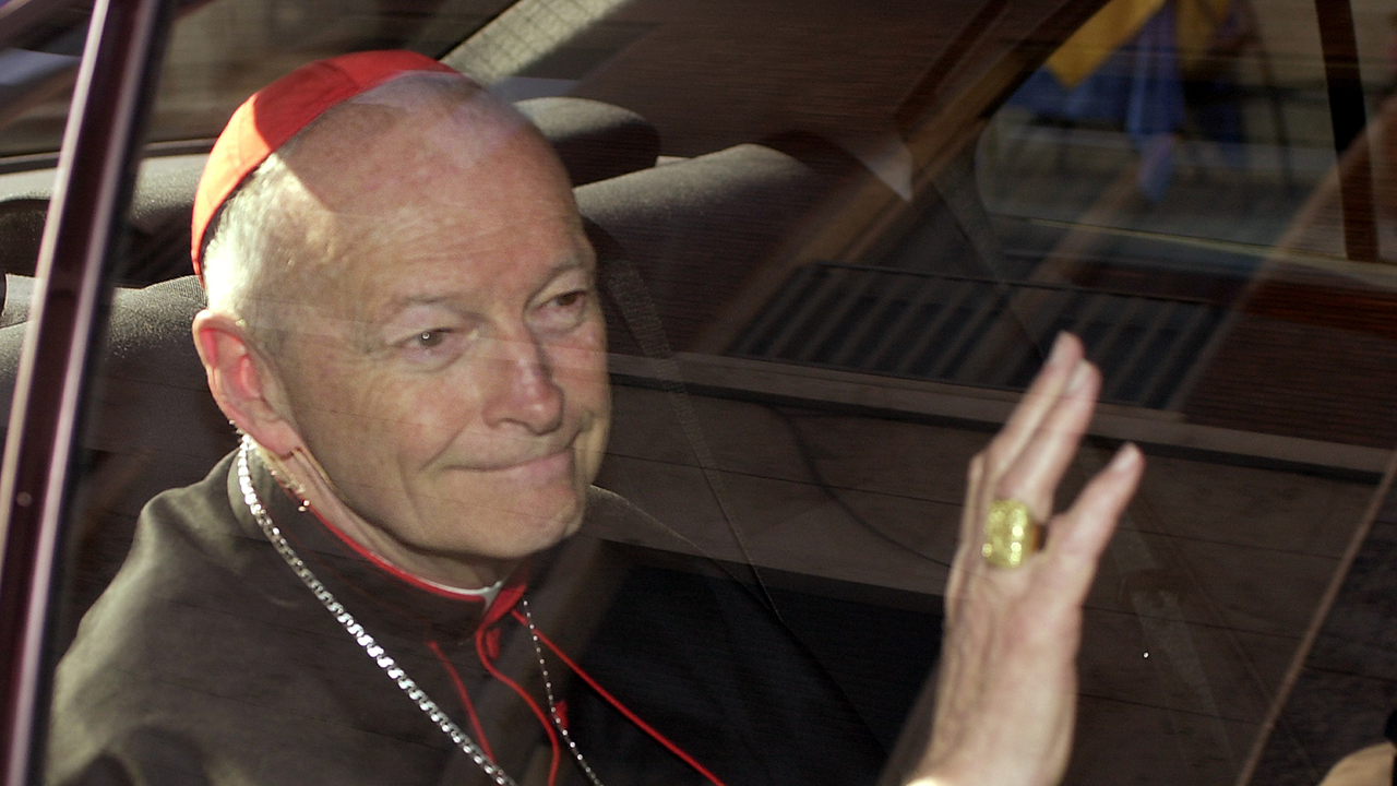 In this April 23, 2002 file photo Cardinal Theodore McCarrick waves as he arrives at the Vatican in a limousine.
