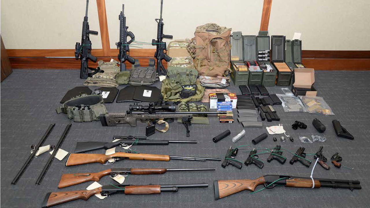 This image provided by the U.S. District Court shows firearms and ammunition that was in the motion for detention pending trial in the case against Christopher Paul Hasson.