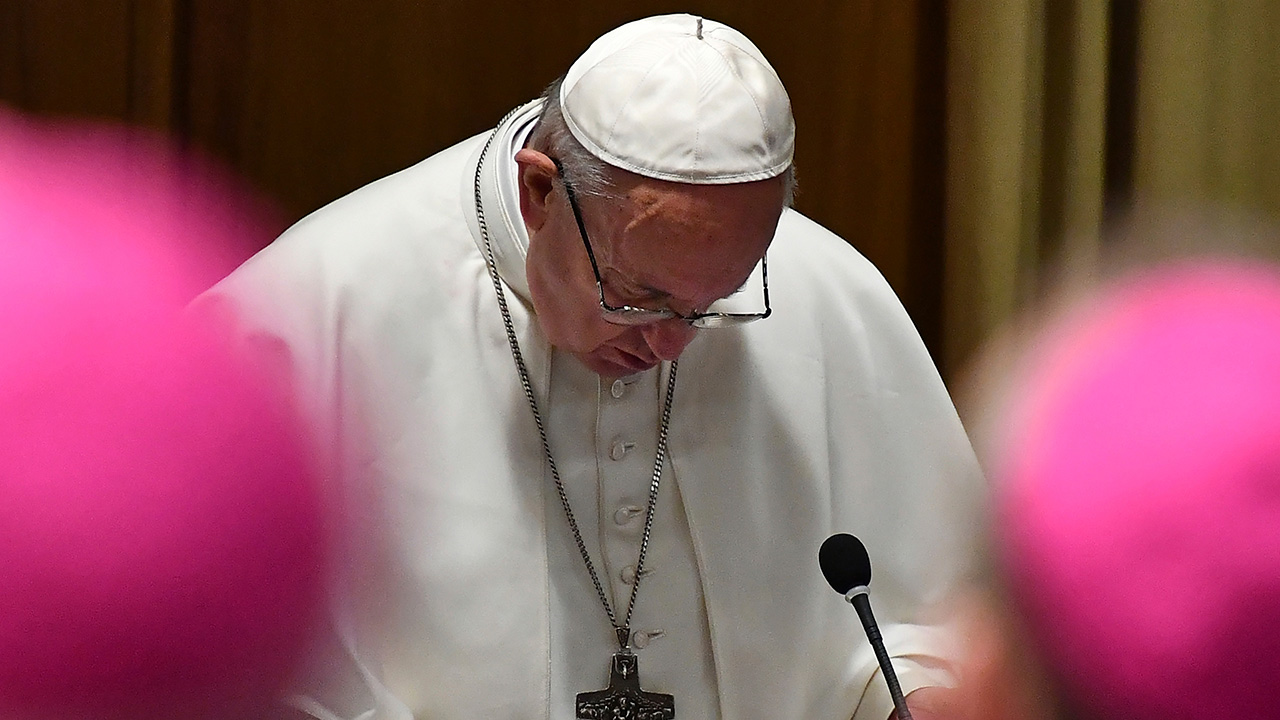 Pope Francis prays at the opening of a sex abuse prevention summit, at the Vatican, Thursday, Feb. 21, 2019.