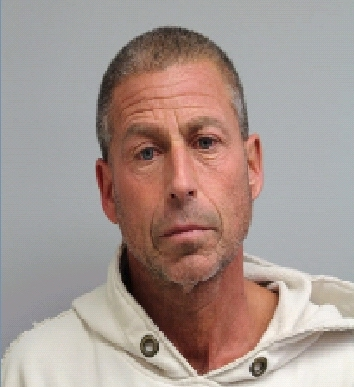 Eric Huska, 58, was charged with involuntary manslaughter after his wife was found unconscious in a hot tub at their home in northwest suburban Wheeling.