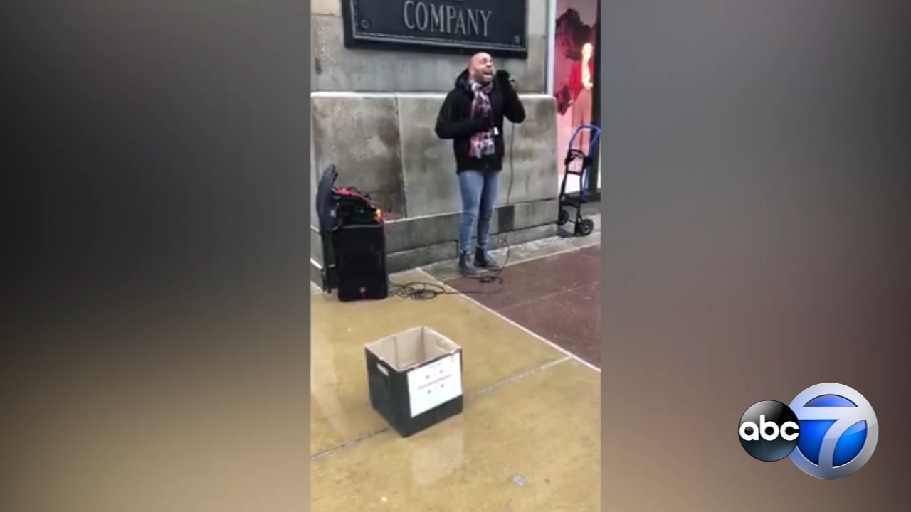 ABC7 photographer Mike Locashio spotted local singer Andrew Johnston performing for a crowd outside Macys on State Street on Sunday.