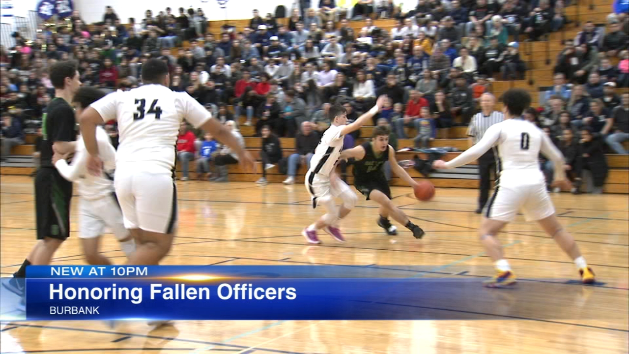 Two fallen Chicago police officers were honored during a high school basketball game Tuesday night.