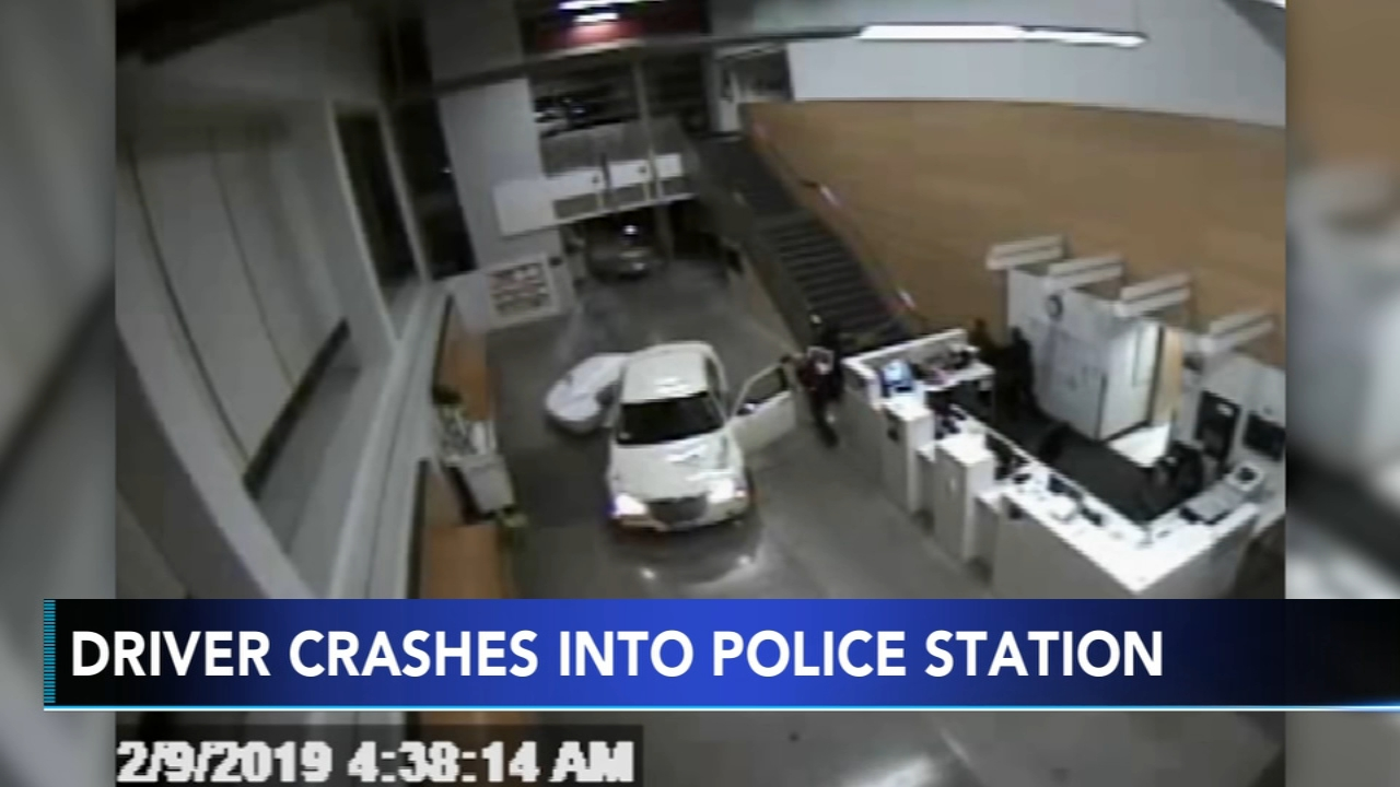 A woman who may have been driving under the influence with a baby in the car crashed into a police station, and it was all caught on camera.
