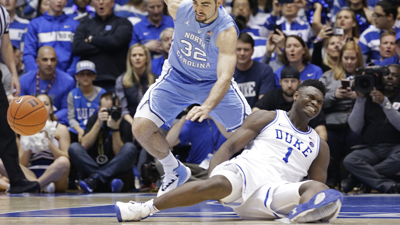 Dukes Zion Williamson falls to the floor with an injury after a freak shoe injury.