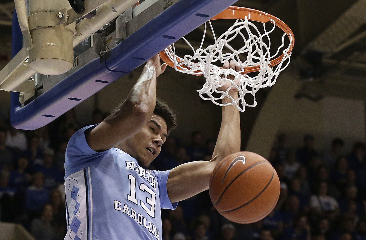 North Carolinas Cameron Johnson (13) dunks against Duke during the first half.