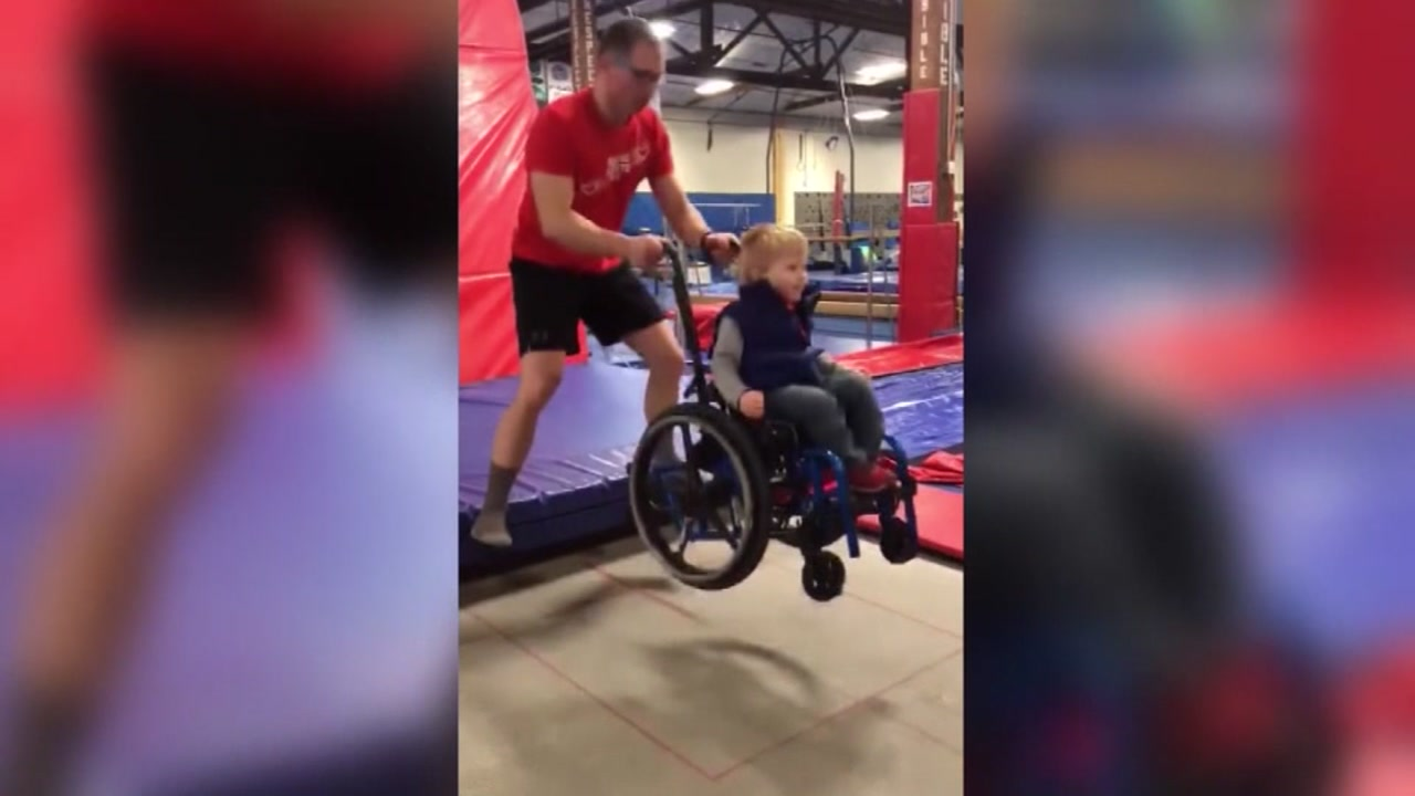 A viral video of a little boy in a wheelchair jumping on a trampoline with his coach is warming hearts around the world.